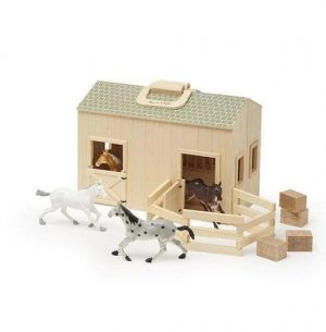 A wooden horse stable toy. There are 4 horses