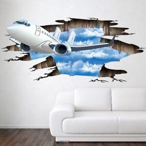 A 3D sticker of a plane flying through a broken wall. There is a white couch in front of the wall.