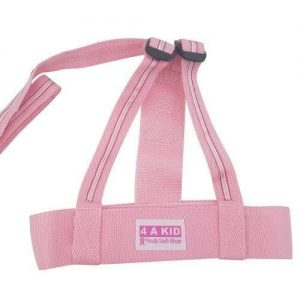 A pink 4aKid child safety harness. It has a 4aKid label attached and a strap.