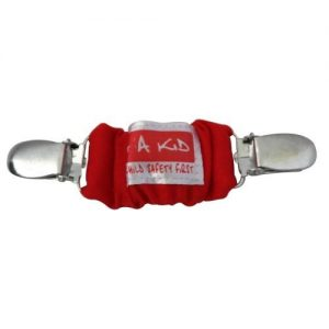 A red 4aKid car strap clip with silver brace clips on either side and the 4aKid label attached.