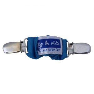A blue 4aKid car strap clip with silver brace clips on either side and the 4aKid label attached.