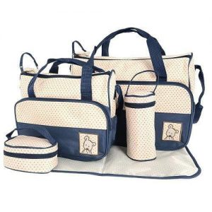 A navy and white baby bag set with polka dots. This set includes a large nappy bag