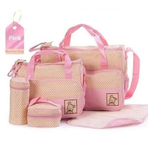 A pink baby bag set with polka dots. This set includes a large nappy bag