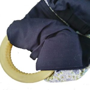 A navy baby kangaroo carrier wrap with 2 nylon rings.