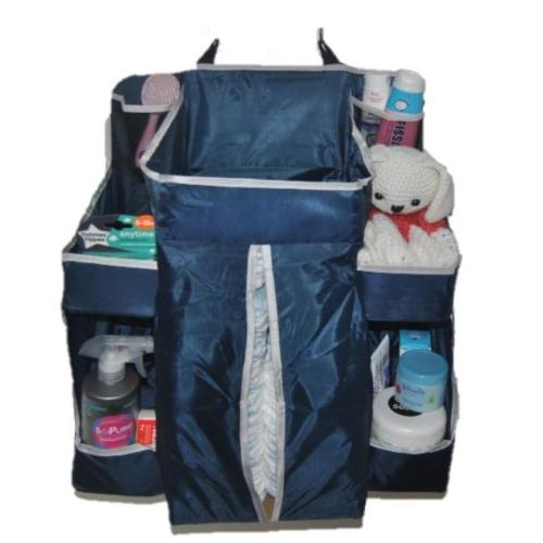 A navy nursery organizer filled with nappies