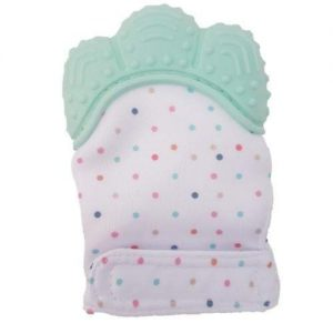 A white teething mitten with different colour polka dots. It has mint green silicone and a velcro strap.