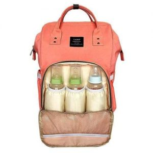 A peach backpack nappy bag. The front pocket is open. It has 3 baby bottles inside.