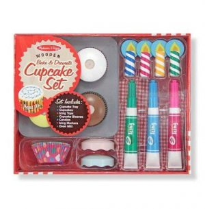 A pretend cupcake set in its packaging. It includes toy candles