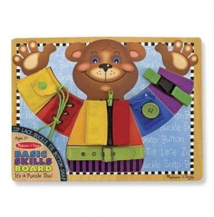 A wooden board with a brown teddy dressed in different colour clothing.