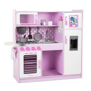 A pretend Cupcake Kitchen by Melissa & Doug assembled with accessories.