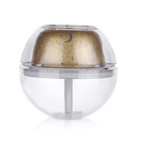 A clear crystal night light humidifier with gold projector.