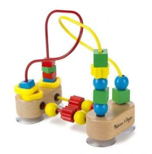A Melissa & Doug wooden bead maze for toddlers. The beads are different colours and there are suction cups under the wooden base.