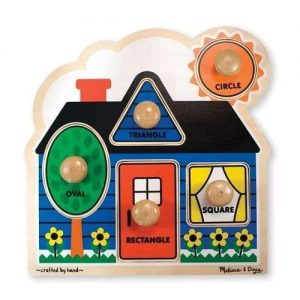 A wooden puzzle in the shape of a house. There are different shape puzzle pieces in different colours.