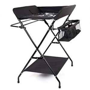 A portable changing table for babies in black. It has a bottom shelf