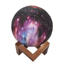 A galaxy moon lamp and humidifier. It is resting on a wooden stand.
