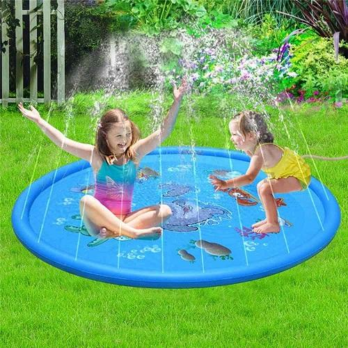 2 girls playing outside on a blue water sprinkler mat.