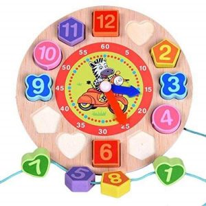 A wooden toy clock for toddlers with removable geometric shape blocks. There is a image of a zebra riding a bike in the centre of the clock. Some shapes have lace running through them.