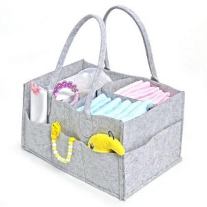 A grey felt nappy organiser filled with nappies