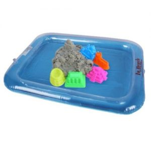 A blue rectangle inflatable tray. It has kinetic sand and different colour moulds inside the tray.