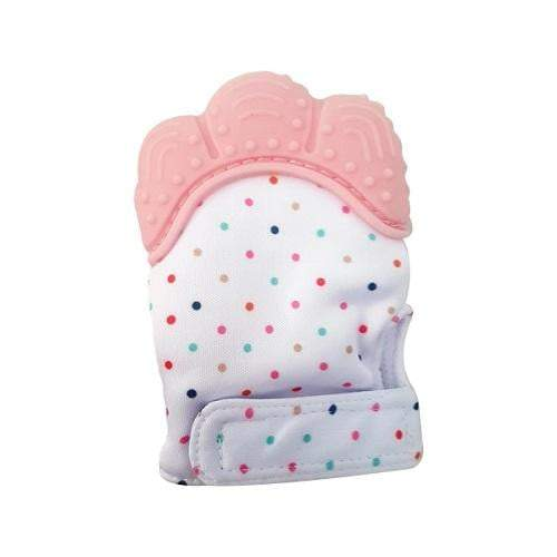 A white teething mitten with different polka dots. It has pink silicone and a velcro strap.