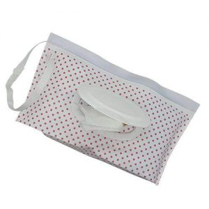A resusable wet wipes pouch with pink polka dot design. It has a white nylon strap.