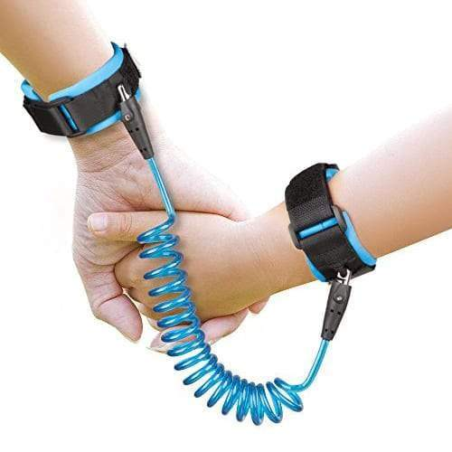 An adults hand is holding a child hands. Both hands are strapped in a blue anti-lost wrist link.